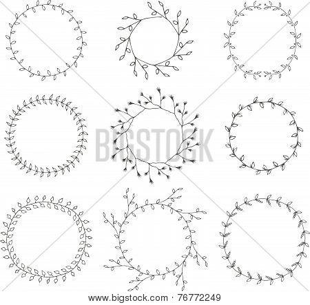 Hand-drawn branches wreaths graphic design elements set