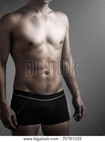 Young Sexy Handsome Man In Black Pants