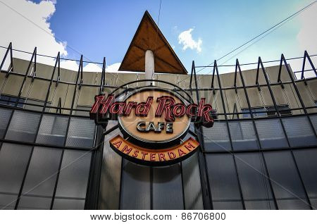 Building facade with Hard Rock Cafe logo agaist blue sky in Amsterdam