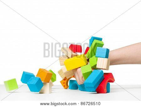 Human Hand Destroying House Made Of Color Wooden Blocks ?????