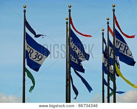 SAN FRANCISCO, CA - NOVEMBER 18: San Francisco Pier 39 flags waving in the sky 2012