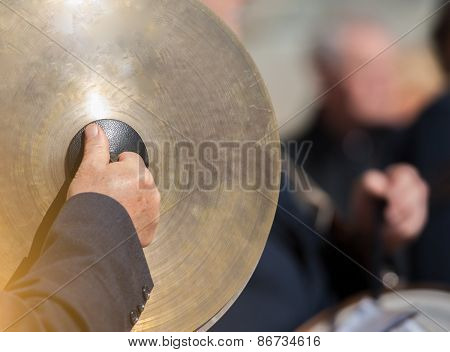 Man Plays The Cymbals During A Religious Cerimony