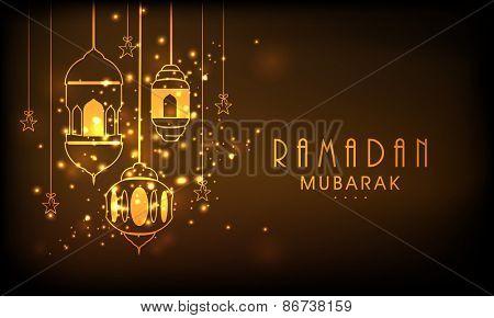 Hanging illuminated lanterns on shiny brown background, concept for Muslim community holy month of prayers, Ramadan Mubarak.
