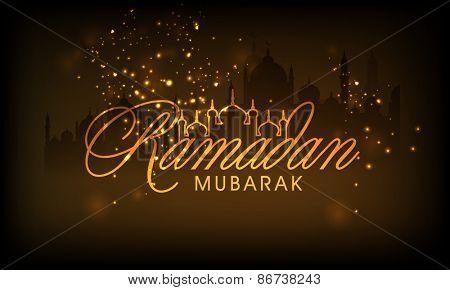 Stylish golden text Ramadan Mubarak on shiny brown background for Islamic holy month of prayers.