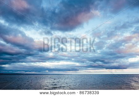 Sunset On Sea Water Ocean Horizon. Sea At Sunset With Some Motion Blur Water, The Sky Is In Beautifu