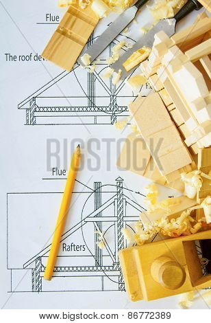 Joiner's works. Drawings for building, small house and working tools on wooden background.