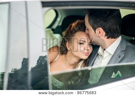 Wedding Couple In The Car