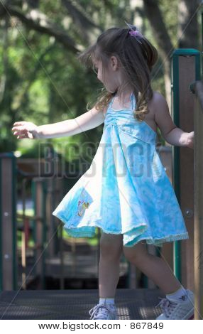 Young Girl Dancing In A Playground