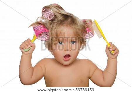 Little Beautiful Kid With Hair Curlers And Comb