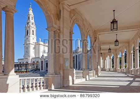 Sanctuary of Fatima, Portugal. Basilica of Our Lady of the Rosary seen from and through the colonnade. One of the most important Marian Shrines and pilgrimage locations for Catholics poster