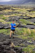 Trail Running fitness male ultra runner in nature landscape, volcanic rocks. Sport running man in cross country trail run. Male athlete exercising and training in summer outdoors. poster