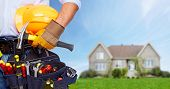Builder handyman with construction tools. House renovation background. poster