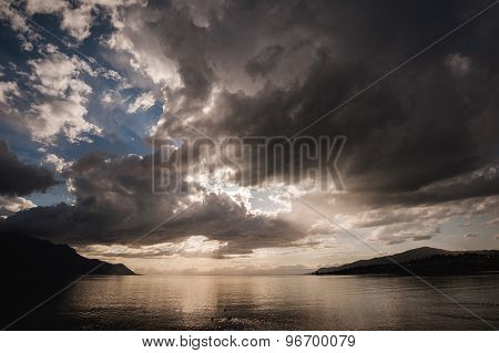 The Clouds At Sunset Over Lake
