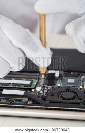 Person Hands Repairing Laptop Motherboard