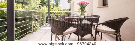 Round Table And Wicker Armchairs