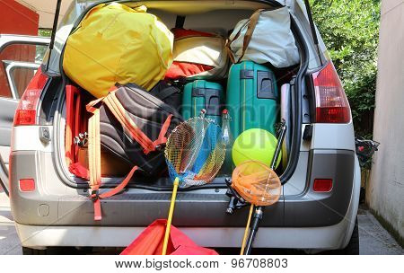 Luggage And Suitcases In Car For Departure For Family Holidays