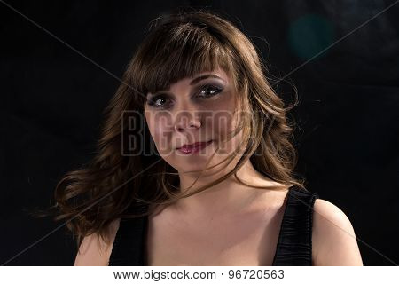 Photo of pudgy woman with flowing hair