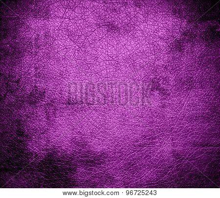 Grunge background of deep fuchsia leather texture