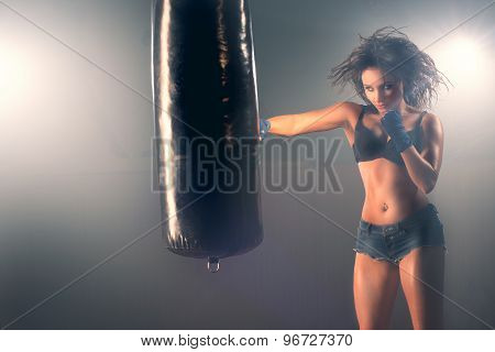 Boxing training woman sparring punching bag