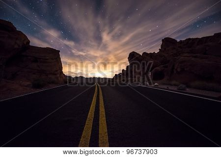 Empty Road Leading Towards The  Rising Moon