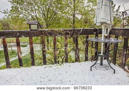 hailstones  covering patio and backyard after violent spring storm