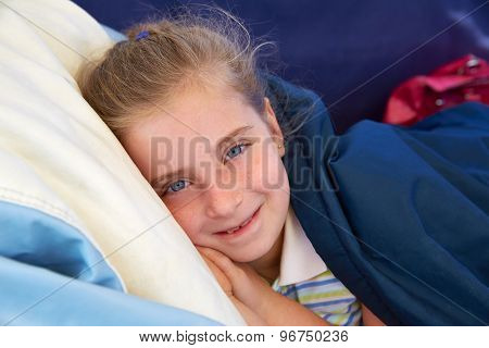 Blond kid girl tired relaxed with indented smile