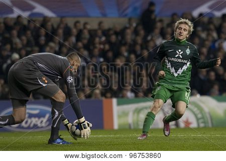 LONDON ENGLAND, November 11 2010: Tottenham's goalkeeper Heurelho Gomes and Werder Bremen's Marko Marin in action during the UEFA Champions League match between Tottenham Hotspur and Werder Bremen