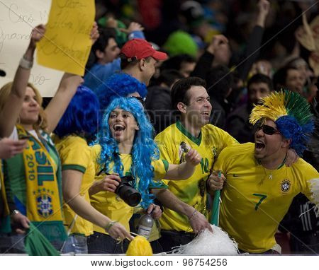 LONDON, ENGLAND. March 02 2010: Brazilian fans celebrate a goal during the international football friendly between Brazil and the Republic of Ireland played at the Emirates Stadium.
