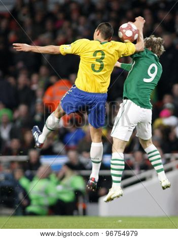 LONDON, ENGLAND. March 02 2010: Brazil's Lucio and Ireland's Kevin Doyle in action during the international football friendly between Brazil and the Republic of Ireland played at the Emirates Stadium.