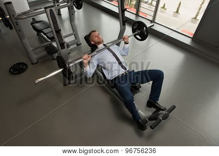 Businessman Exercise Bench Press With Barbell