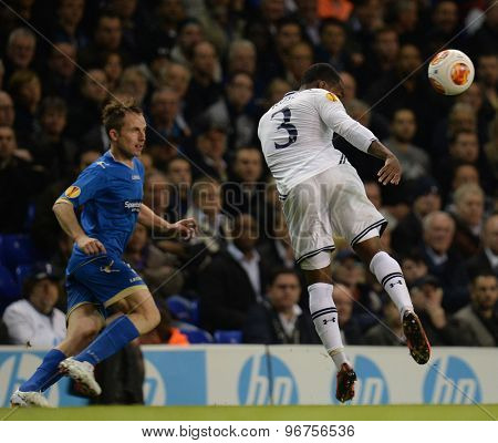 LONDON, ENGLAND - September 19 2013: Tottenham's Danny Rose  heads the ball during the UEFA Europa League match between Tottenham Hotspur and Tromso played at The White Hart Lane Stadium.
