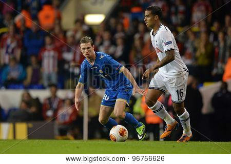 LONDON, ENGLAND - September 19 2013: Tromso's Thomas Drage  and Tottenham's Kyle Naughton  during the UEFA Europa League match between Tottenham Hotspur and Tromso played at The White Hart Lane