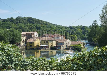 BORGHETTO, ITALY - JULY 11: Village of Borghetto surrounded by vegetation and coasted by river Mincio. July 11, 2015 in Borghetto.