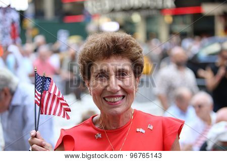 Rally attendee with US flags