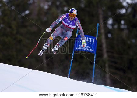 GARMISCH PARTENKIRCHEN, GERMANY. Feb 10 2011: Erik Guay (CAN) takes to the air competing in the men's downhill training at the 2011 Alpine Skiing World Championships
