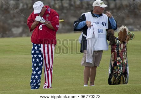 ST ANDREWS, SCOTLAND. July 18 2010: John DALY from the USA lights up a cigarette  during the final round of The Open Championship   played on The Royal and Ancient Old Course