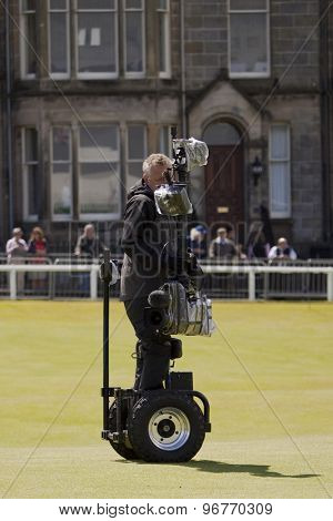 ST ANDREWS, SCOTLAND. July 17 2010: A  BBC cameraman on a specially designed motorised rig during the third round of The Open Championship   played on The Royal and Ancient Old Course