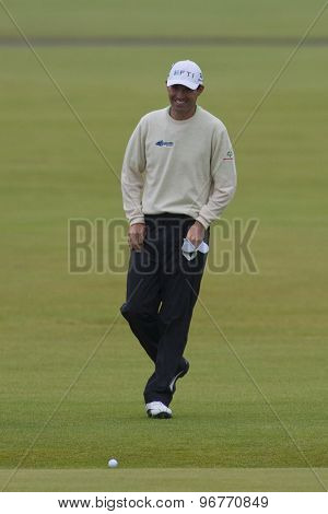 ST ANDREWS, SCOTLAND. July 15 2010: Padraig HARRINGTON from the Republic of Ireland laughing after he jumps across the burn on the first hole during the first day of The Open Championship