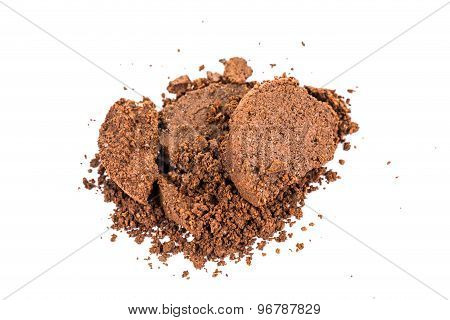 Spent or used coffee grounds in white background