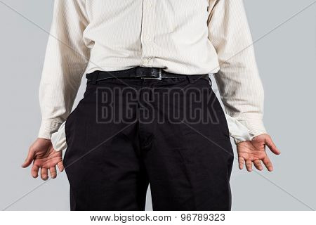 Concept of depressed man with empty pockets gesture with his hands