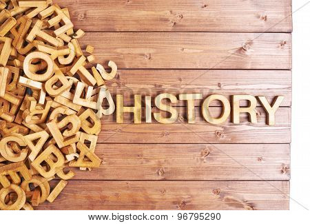 Word history made with wooden letters