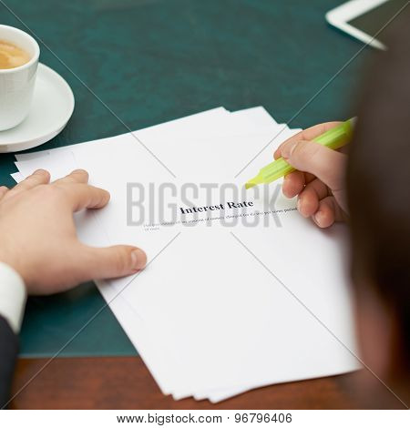 Marking words in an interest rate definition, shallow depth of field composition poster