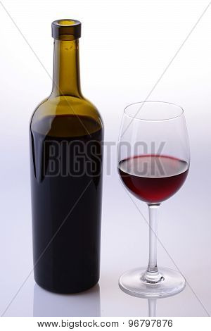 Green Bottle And Wine Glass