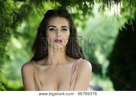 Portrait Of Sensual Woman In Garden