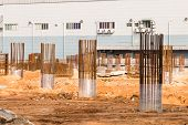 Foundation pillars and columns being built at construction site poster