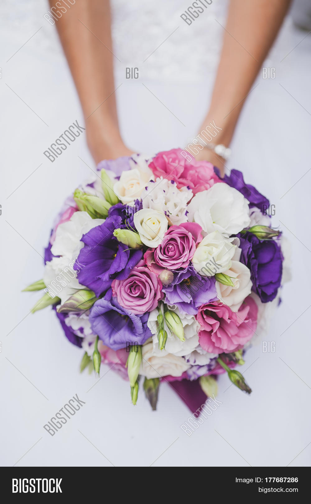 Bride white wedding image photo free trial bigstock bride in a white wedding dress holding a flowers bouquet from purple rose in hands mightylinksfo