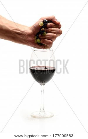 Strong Male Hand Squeezing Wine From Grapes To Glass