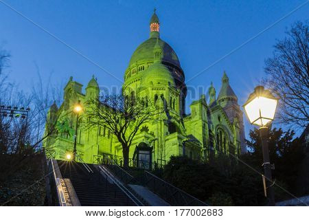 The Basilica Sacre Coeur lit with green light for celebrate St Patrick's Day Paris France