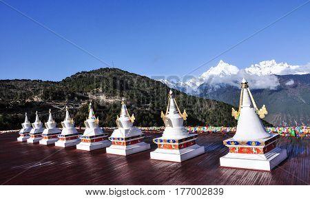Tibetan Stupa With Snow Mountain Background