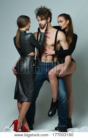 Two Pretty Girls Hugging Bearded Man With Beard
